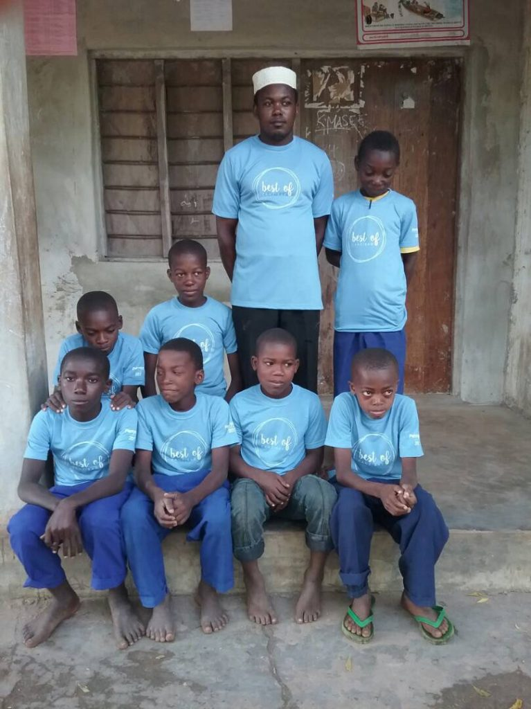 BOZ teacher Idrissa Makame Sijona with some of his Standard V-VI Maths students